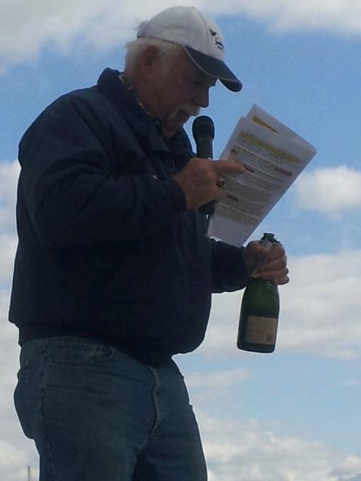 Chaplain Ron Dixon reads the traditional denaming recitation.