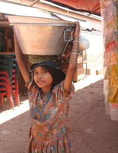 41 Girl  at market posing with tub