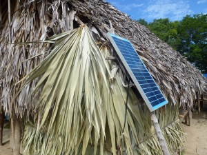 Large solar panel on thatched roof