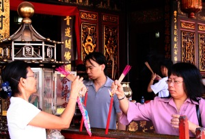 Lighting incense at the temple