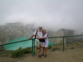 Lois and Gunter in front of green teal crater lake