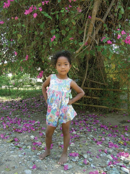 Petal Girl. Riung, Malaysia. From The Long Way Back by Lois Joy Hofmann
