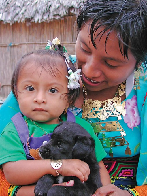 Mother, baby, and puppy. Mamitupu, San Blas Archipelago, Panama