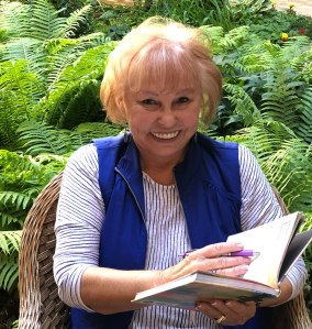 Lois Joy Hofmann updating her travel journal.