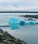 Icebergs float down the river and out to sea
