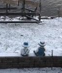 Swedish-Couple-observes-dusting-of-snow-while-boat-launch-stays-on-shore