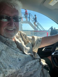 Gunter at the wheel on the car ferry to Madeline Island.