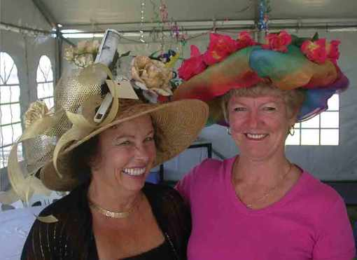 Lois and Pat wearing their hats for the contest