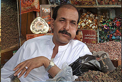 Sana'a vendor chewing qat in market
