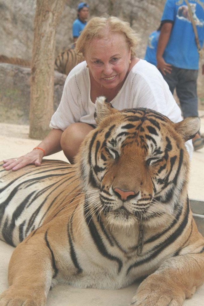 Posing with a tiger